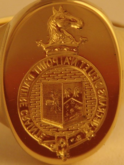 Signet ring seal-engraved (cut in reverse to make a positive impression in wax) with horse crest. Motto lettering is about 3/4 of a millimeter high.